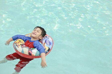 float tube: Bangkok Thailand - September 2015 Summer outdoor activity of little Thai boy in Bangkok, Thailand Editorial