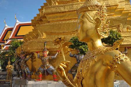 phra si rattana chedi: Many of the statues and figurines at Wat Phra Kaew or The Emerald Buddha in Bangkok, Thailand