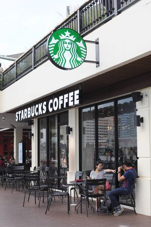 tha: Bangkok, Thailand - October 10, 2015: New branch of Starbucks Coffee is located at the THA MAHARAJ New community mall