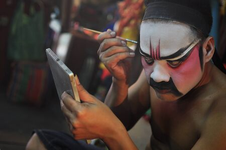 drama mask: BANGKOK THAILAND - October 2011: Actor and actress makeup for Chinese opera. Chinese opera is an ancient drama in musical way Editorial