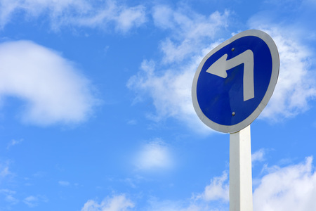 turn left: Turn left arrow sign on blue sky with cloud background for giving directions