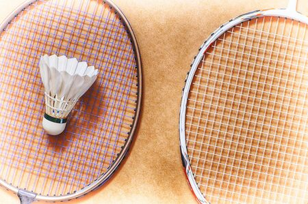 healthiness: Healthiness concept and sport background idea, shuttlecock on badminton racket