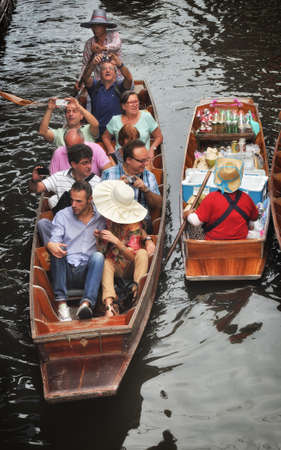 damnoen saduak: RATCHABURI, THAILAND - NOVEMBER 24: Many tourists on small boat at Damnoen Saduak floating market in RATCHABURI THAILAND, popular tourist attraction on NOVEMBER 24, 2013