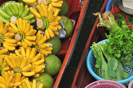 damnoen saduak: Tropical fruits and vegetables product in boat for selling at Damnoen Saduak floating market in Ratchaburi province, Thailand. The market is open everyday from around 06.00 to 11.00am Stock Photo