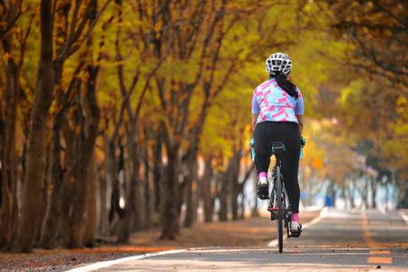 Sportswoman ride bike, keep going idea