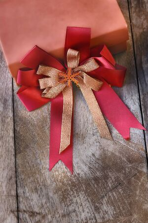 Gift box with ribbon on wooden background, celebration concept Stock Photo