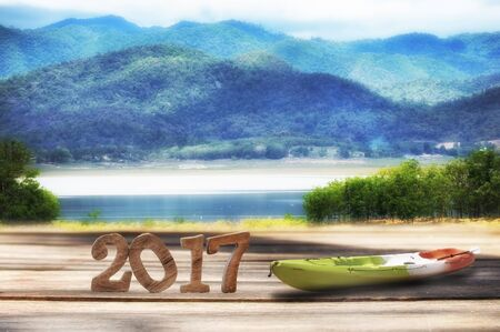 Happy new year 2017 on wooden plank and mountain landscape view background, happy summer holiday concept and nature idea Stock Photo