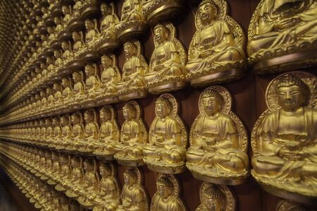 Pattern of golden Chinese Buddha at Wat Leng Nei Yi 2 or Borom Raja Kanchanapisek Anusorn temple in Nonthaburi province, Thailand