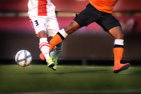 Player legs of soccer sport with ball