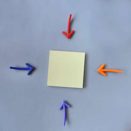lay forward: Input text idea, top view of colorful arrow and yellow sticky note on grey background, business concept