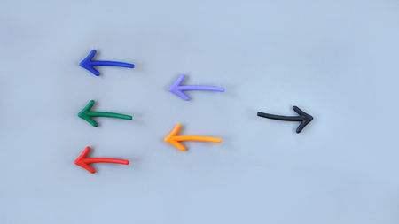 Business stand out concept: Top view of colorful arrow on grey background Stock Photo