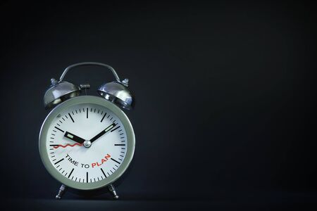 Time to plan words on alarm clock on black background, business concept and time management idea Stock Photo