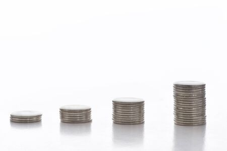 Stack of coins on white background, business success concept and growth idea