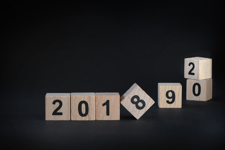 begin: 2018, 2019 and 2020 on black background, happy new year concept and holiday and event idea
