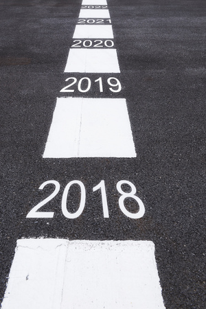 Number of 2018 to 2022 on asphalt road surface with marking lines, happy new year concept