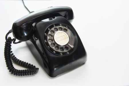 白い背景に、選択と集中の考えにヴィンテージの黒電話 写真素材