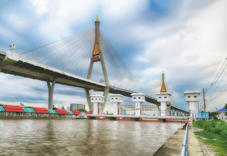 SAMUT PRAKAN, THAILAND - AUGUST 22, 2017: View from Lat Pho canal floodgates with Bhumibol bridge 1 and local people lifestyle. The bridge is the northern bridge and links Bangkok and Samut Prakan province Editorial