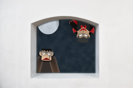 Dracula and Frankenstein with moon on clerestory window on wall background