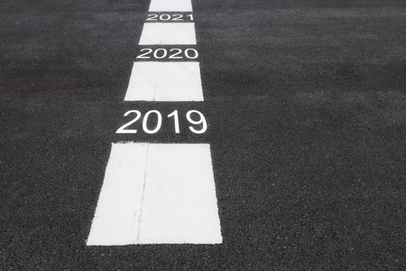 Number of 2019 to 2023 on asphalt road surface, business concept