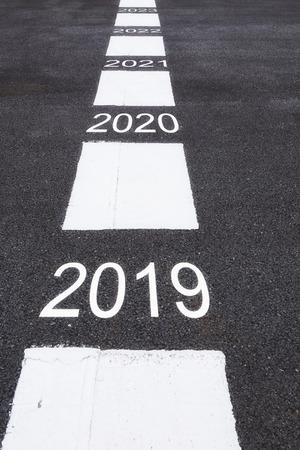 Number of 2019 to 2023 on asphalt road surface, business concept