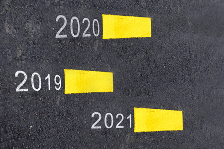 Number of 2019 to 2021 on asphalt road surface with marking lines, happy new year concept