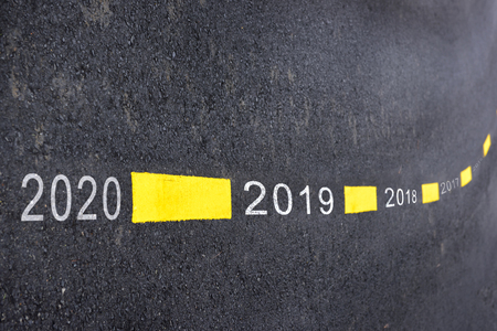 Number of 2019 to 2020 on asphalt road surface with marking lines, happy new year concept