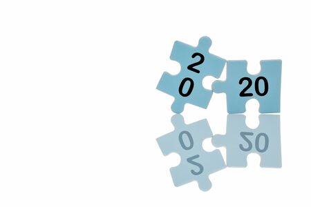 New year 2020 on blue puzzle with reflection on white background, business concept and success idea
