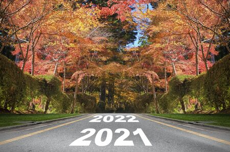 Road 2021 to 2022 with autumn season background, new year road trip concept and fall color idea
