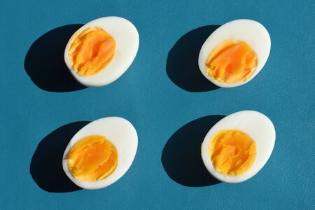 Boiled egg with shadow on blue