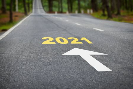 New year 2021 on asphalt road surface with white arrow, new normal concept and happy new year idea