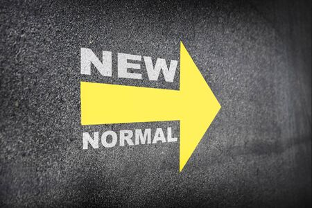 New normal word with yellow arrow on road, Business challenge concept and keep moving idea Фото со стока
