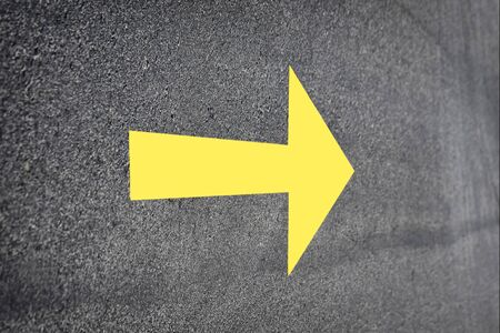 Yellow arrow on road surface, Business challenge concept and keep moving idea