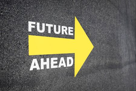 Future ahead word with yellow arrow on road surface, Business challenge concept and keep moving idea