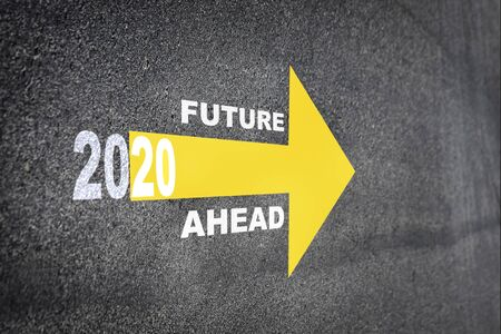 New year 2020 and future ahead word with yellow arrow on road surface, Business challenge concept and keep moving idea Фото со стока