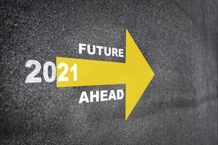 New year 2021 and future ahead word with yellow arrow on road surface, Business challenge concept and keep moving idea