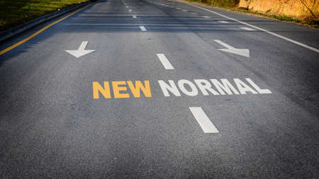 New normal word with white arrow on road, Business challenge concept and keep moving idea