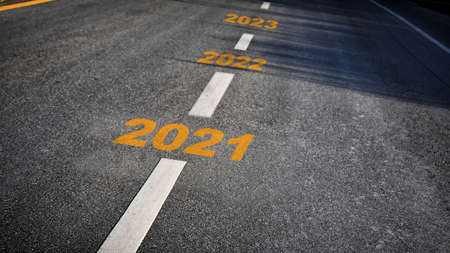 Year 2021 to 2023 on asphalt road, happy new year concept and productive business success idea