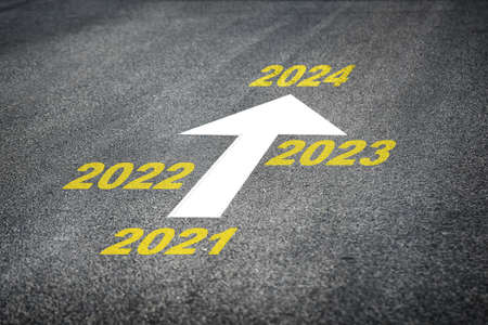 Year 2021 to 2024 and white arrow marking on road surface, business challenge concept and keep mtrying idea