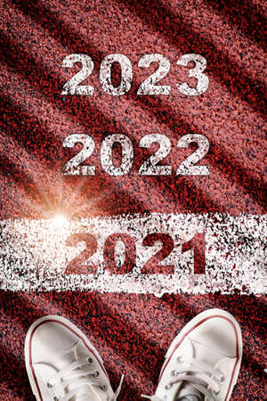 Top view new year 2021 to 2023 on road surface with marking lines, happy new year concept
