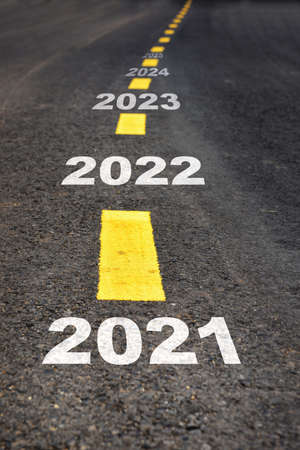 Number of 2019 to 2023 on asphalt road surface with marking lines, happy new year concept