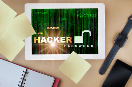 Hacker unlock password with pattern of green binary code decimal on computer tablet screen on desk. Hacker background concept and data protection idea