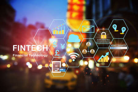 Financial technology or fintech icon on abstract bokeh night city on road background. Investment technology concept and internet of thing with double exposure idea Stock fotó
