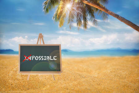 Impossible word without im on blackboard on tropical beach background, business challenge concept and have big dream idea