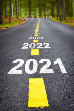 Journey to new year 2021 to 2026 on asphalt road surface with marking lines, happy new year concept