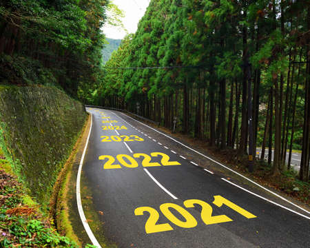 Ten year from 2021 to 2030 on highway road and white marking lines in the forest, Happy new year and road to success concept