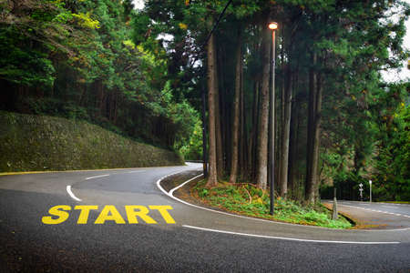 Start word on road curve. Business challenge concept and keep trying idea