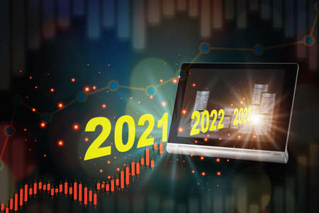 New year 2021, 2022 and 2023 out of computer tablet with stack of coins screen on growth graph background. Digital technology online concept and wealthy idea