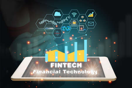 Financial technology words on smart phone screen with fintech theme background. Investment technology innovation concept and internet of thing idea