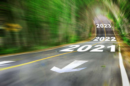 New year 2021, 2022 and 2023 on Motion blurred view of high speed road. Business challenge concept and competition idea