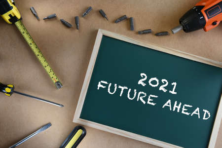 2021 future ahead on chalkboard with tools supplies on brown background. Business challenge concept and effort idea Stock fotó - 158209565